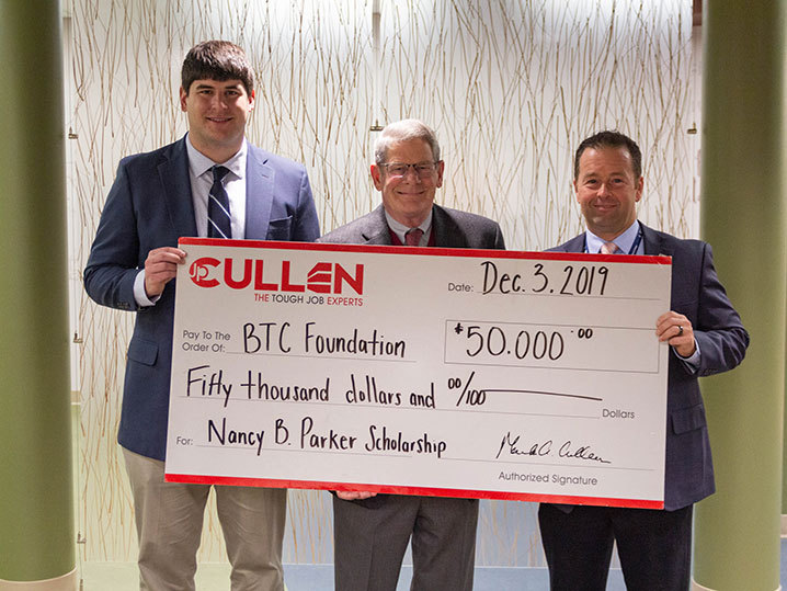 JP Cullen and BTC President holding donation check