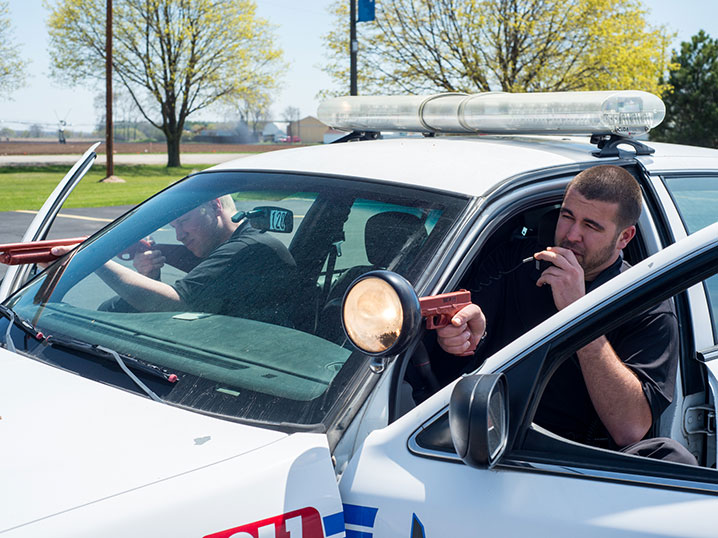 Academy Students in Police Car during Training Scenario