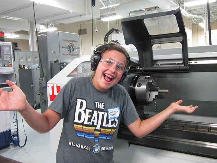 student smiling by machine