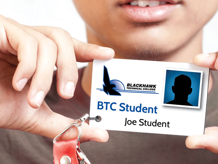 student holding student ID card