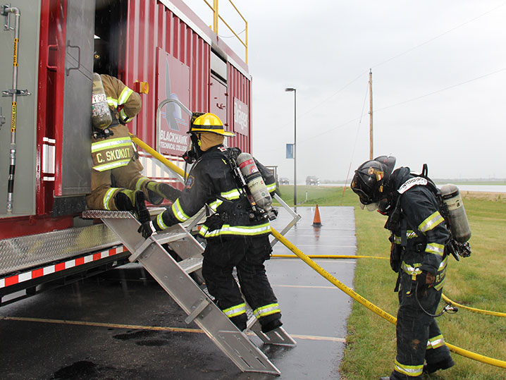 fire students training in parking lot