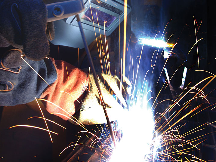 Student Welding with Sparks